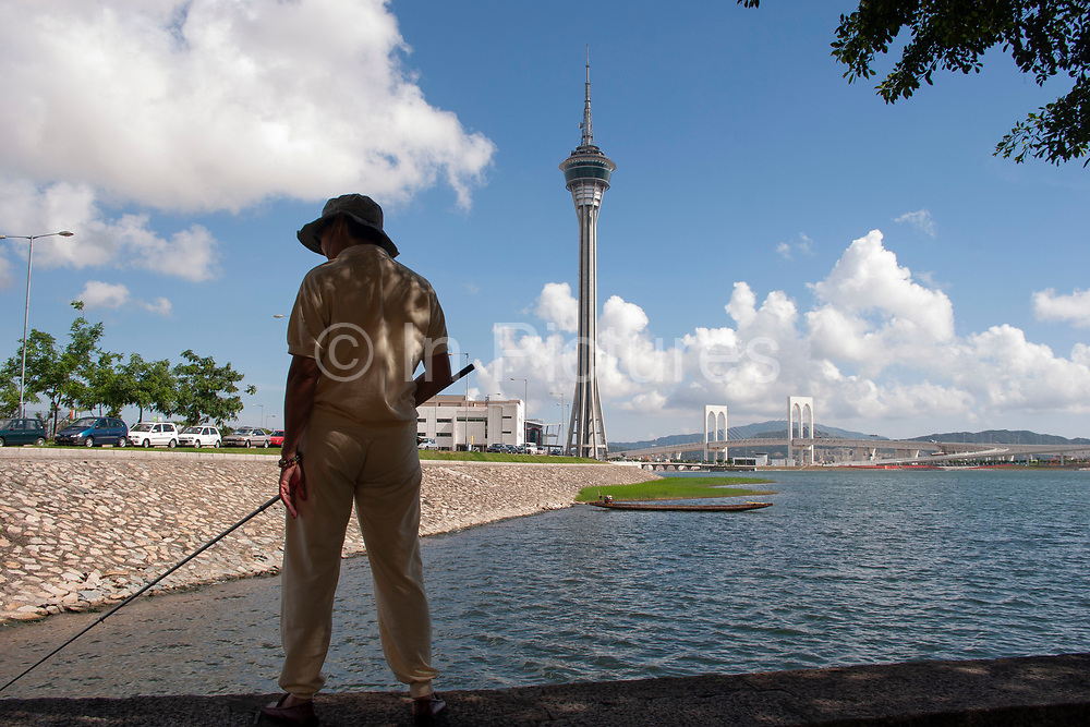 Fishing in Macau, China. Macau is an autonomous region on the south coast of China, across from Hong Kong. A Portuguese territory until 1999, it reflects a mix of cultural influences.