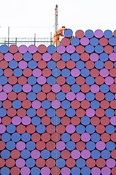 © Licensed to London News Pictures. 07/06/2018. London, UK. A construction workers work on the CHRISTO and JEANNE-CLAUDE'S 'The Mastaba' sculpture in Hyde Park's Serpentine Lake. The artwork is made from 7,506 specially fabricated multi-coloured barrels and will float in the middle of the lake.Photo credit: Ray Tang/LNP