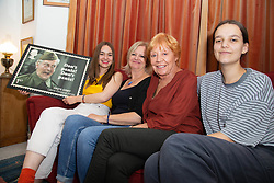 L-R Granddaughter Alice, Daughter Jessica and wife Priscilla Morgan and grand daughter Lydia admire a stamp design featuring Dad's Army's Clive Dunn. London, June 04 2018.
