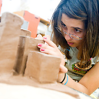 041113     Brian Leddy<br /> Shawnna Boardman works on her art project during a ceramics class at the University of New Mexico-Gallup Thursday.