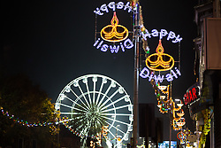 """© Licensed to London News Pictures. 01/11/2015. Leicester, UK. More than 35,000 people were estimated to have attended the annual Diwali ight switch-on which took place along the named """"Golden Mile"""" in Belgrave Road, Leicester. Pictured, the Diwali lights on the Belgrave road. Photo credit : Dave Warren/LNP"""