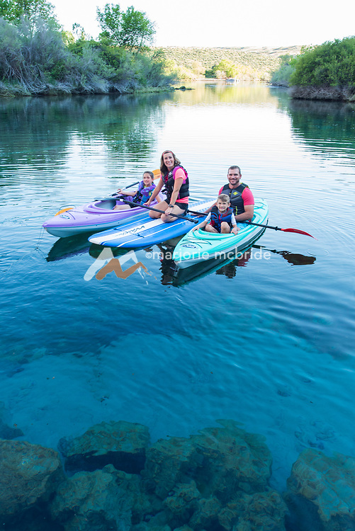 Family kayaking and SUP boarding Blue Heart Springs on the Snake River Hagerman, Idaho. MR