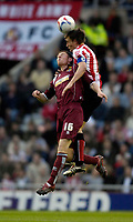 Photo: Jed Wee/Sportsbeat Images.<br /> Sunderland v Burnely. Coca Cola Championship. 27/04/2007.<br /> <br /> Sunderland's Dean Whitehead (R) jumps to win the ball from Burnley's Chris McCann.