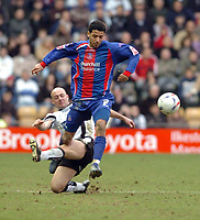 Photo: Leigh Quinnell.<br /> Derby County v Crystal Palace. Coca Cola Championship. 25/03/2006. Palaces' Jobi McAnuff is brought to ground by Derbys Alan Wright.