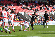 Portsmouth FC midfielder Gareth Evans (26) missis close range shot at goal during the EFL Sky Bet League 1 match between Doncaster Rovers and Portsmouth at the Keepmoat Stadium, Doncaster, England on 25 August 2018.Photo by Ian Lyall.