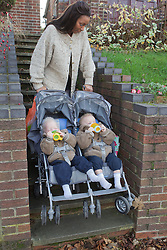 Mother going up steps with twins in buggy. (This photo has extra clearance covering Homelessness, Mental Health Issues, Bullying, Education and Exclusion, as well as the usual clearance for Fostering & Adoption and general Social Services contexts,)
