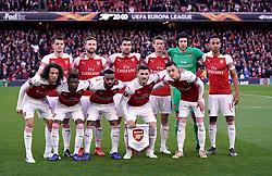Arsenal team group. (Left-right) Front Row: Matteo Guendouzi, Ainsley Maitland-Niles, Alexandre Lacazette, Sead Kolasinac and Mesut Ozil. Back Row: Granit Xhaka, Shkodran Mustafi, Sokratis Papastathopoulos, Laurent Koscielny, goalkeeper Petr Cech and Pierre-Emerick Aubameyang