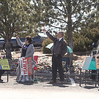 Kitty Olguin, left, and Earl Andrew Yearley stand and give a thumbs-up to passing drivers on Second Street as they campaign outside the Southside Fire Station No. 1 Tuesday, March 3 for the 2020 Municipal Officer Election in Gallup.