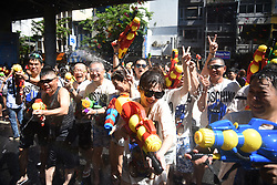 April 13, 2018 - Bangkok, Thailand - Both Thai and foreign tourists hold  water gun joining Songkran festival at Silom road in Bangkok.''The Songkran Water Festival Campaign Safe 2018 '' will be held from 13th to 15th April. (Credit Image: © Vichan Poti/Pacific Press via ZUMA Wire)