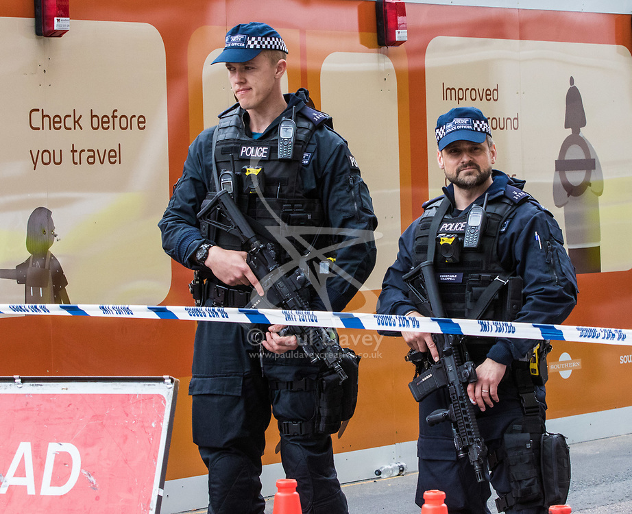 London, June 4th 2017. Armed police on outside London Bridge Station during a massive policing operation in the aftermath of the terror attack on London Bridge and Borough Market on the night of June 3rd which left seven people dead and dozens injured