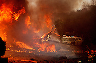 SAN DIEGO, CA: Fire rages in a neighborhood in the University City area of San Diego, California killing two adults and a child in their home. An FA-18 military jet crashed during a training exercise.  The pilot ejected and suffered minor injuries.