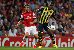 27.08.2013, Emirates Stadion, London, ENG, UEFA CL Qualifikation, FC Arsenal vs Fenerbahce Istanbul, Rueckspiel, im Bild Arsenal's Nacho Monreal and Fernerbache's Emmanuel Emenike during the UEFA Champions League Qualifier second leg match between FC Arsenal and Fenerbahce Istanbul at the Emirates Stadium, United Kingdom on 2013/08/27. EXPA Pictures © 2013, PhotoCredit: EXPA/ Mitchell Gunn<br /> <br /> ***** ATTENTION - OUT OF GBR *****