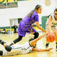 Thoreau Hawk Rylee DeGroat (14), left, dives for a ball with Kirtland Central Bronco Megan Silversmith (33) and Hawk Katelin Plummer (21) at Thoreau High School Friday.