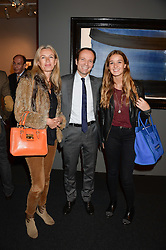 Left to right, LISA ISVY, STEPHANE CUSTOT and CAMILLE ISVY at the PAD Art and Design Fair 2013 Collectors Preview in Berkeley Square, London on 14th October 2013.