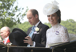 The Duke and Duchess of Cambridge getting into their carriage to take part in the parade during Royal Ascot at Ascot Racecourse.