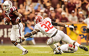 Sep 14, 2013; College Station, TX, USA; Texas A&M Aggies running back Ben Malena (1) runs past Alabama Crimson Tide linebacker C.J. Mosley (32) during the first half at Kyle Field. Mandatory Credit: Thomas Campbell-USA TODAY Sports