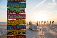 Liepaja, Latvia - August 22, 2015: A sign marks the distances to several cities around the world from the beach in Liepaja, Latvia