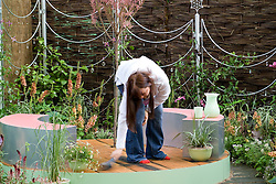 Sweeping up in preparation for the Chelsea Flower Show. The Crystal Cobweb Garden. Designer:  Freya Lawson - Chelsea 2005
