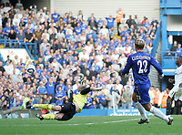 Photo: Lee Earle.<br /> Chelsea v Bolton Wanderers. The Barclays Premiership.<br /> 15/10/2005. Chelsea's Eider Gudjohnsen beats Bolton keeper Jussi Jaaskelainen to score number five.