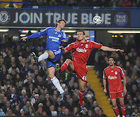 Photo: Tony Oudot/Sportsbeat Images.<br /> Chelsea v Liverpool. Carling Cup, Quarter Final. 19/12/2007.<br /> Andriy Shevchenko of Chelsea goes up for a header with Jack Hobbs of Liverpool