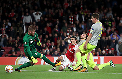 Arsenal's Hector Bellerin (centre) scores his side's third goal of the game during the Europa League match at the Emirates Stadium, London.