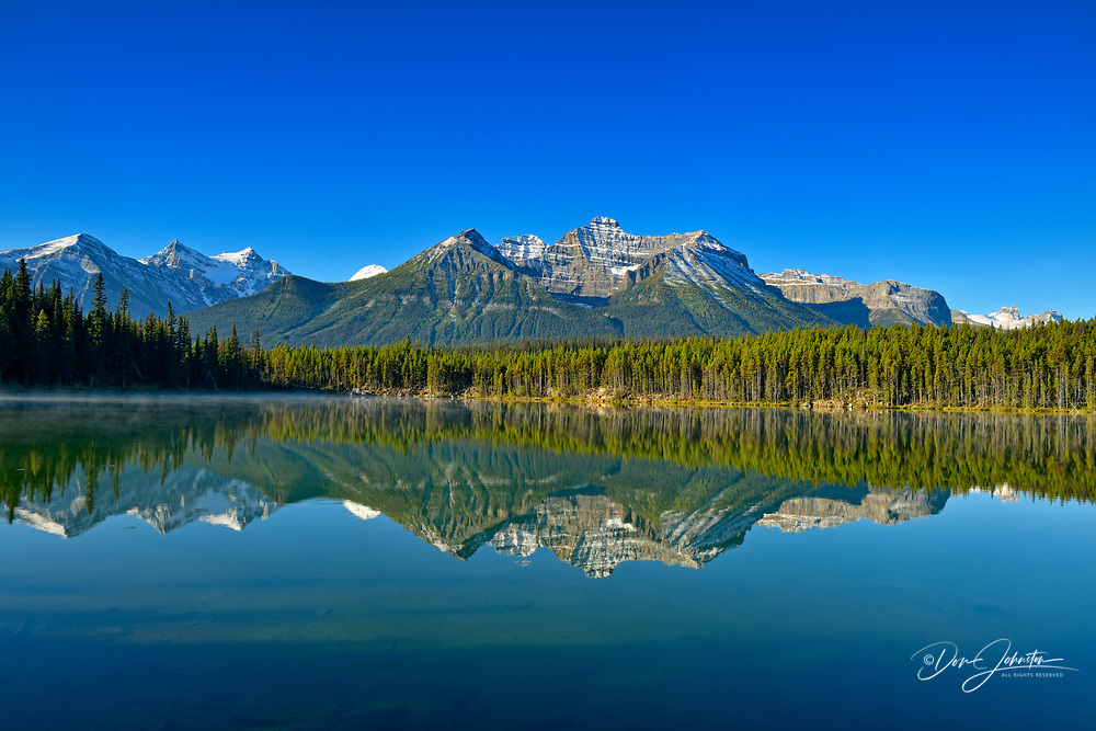 The Bow Range reflected in Herbert Lake, Banff National Park, Alberta, Canada
