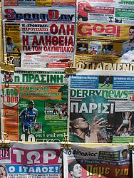 Detail of Greek sports newspapers on rack