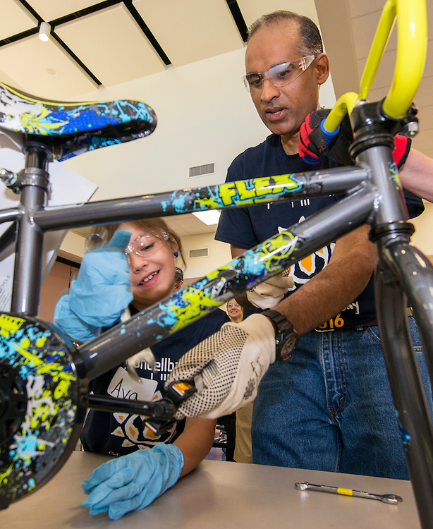 LyondellBasell CEO Bob Patel assembles bicycles to be awarded to students that meet reading goals at Sherman Elementary School, September 10, 2016.