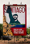 Poster of Fidel Castro lit in neon lights with his proclamation The Revolution, it can never be crushed!, July 1984,  Havanna, Cuba. Fidel Alejandro Castro Ruz was a Cuban revolutionary and politician who governed the Republic of Cuba as Prime Minister from 1959 to 1976 and then as President from 1976 to 2008. He was loved by most of the people as a champion of socialism and anti-imperialism whose revolutionary regime advanced economic and social justice while securing Cubas independence from American imperialism.