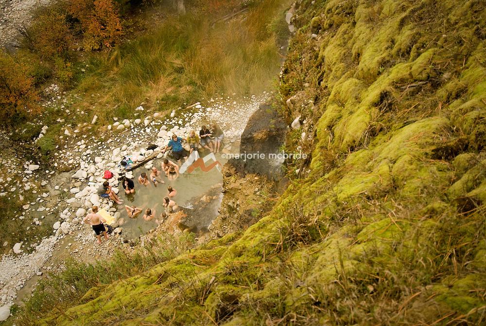 Group enjoying the Chattanooga hot springs during autumn, Atlanta, Idaho .