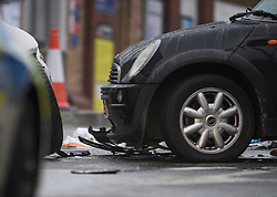 © Licensed to London News Pictures. 24/11/2019. London, UK. Damage to the front end of a car involved in a collision, at the scene where a man has been found stabbed to death outside a west London train station. The attack follows a stabbing in Whitechapel on Saturday, in which another man in his 20s was killed. Photo credit: Ben Cawthra/LNP