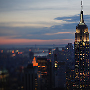 A view of the Empire State Building and Manhattan, New York, at dusk from the Top of the Rock, the observatory deck at Rockefeller Center showing the Empire State Building, Manhattan, New York, USA.  Photo Tim Clayton
