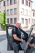 person getting in his car during the Covid 19 crisis and lockdown France Limoux April 2020
