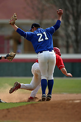 15 February 2007: Casey Martin impedes the path of a redbird base runner.  The umpires originally called the runner out, but after a conference , the call was reversed.  Play continued after an appeal and the ejection of Sycamore coach Lindsay Meggs.  Indiana State Sycamores gave up the first game of the double-header by a score of 16-6 to the Illinois State Redbirds at Redbird Field on the campus of Illinois State University in Normal Illinois.