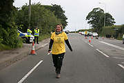 12 local activists locked themselves in specially made arm tubes to block the entrance to Quadrillas drill site in New Preston Road, July 03 2017, Lancashire, United Kingdom. Councillor Miranda Cox arrived back to the protest after having been released from jail. The 13 activists included 3 councillors; Julie Brickles, Miranda Cox and Gina Dowding and Nick Danby, Martin Porter, Jeanette Porter,  Michelle Martin, Louise Robinson,<br /> Alana McCullough, Nick Sheldrick, Cath Robinson, Barbara Cookson, Dan Huxley-Blyth. The blockade is a repsonse to the emmidiate drilling for shale gas, fracking, by the fracking company Quadrilla. Lancashire voted against permitting fracking but was over ruled by the conservative central Government. All the activists have been active in the struggle against fracking for years but this is their first direct action of peacefull protesting. Fracking is a highly contested way of extracting gas, it is risky to extract and damaging to the environment and is banned in parts of Europe . Lancashire has in the past experienced earth quakes blamed on fracking.