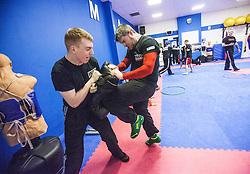 Students kneeing pads as Stef Noij, KMG Instructor from the Institute Krav Maga Netherlands, takes the IKMS G Level Programme seminar today at the Scottish Martial Arts Centre, Alloa.