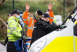 Hertfordshire Police officers arrest an anti-HS2 activist who used a tripod to block one of several entrances to the Chiltern Tunnel South Portal site for the HS2 high-speed rail link for the entire day on 9 October 2020 in West Hyde, United Kingdom. The protest action, at the site from which HS2 Ltd intends to drill a 10-mile tunnel through the Chilterns, was intended to remind Prime Minister Boris Johnson that he committed to remove deforestation from supply chains and to provide legal protection for 30% of UK land for biodiversity by 2030 at the first UN Summit on Biodiversity on 30th September.