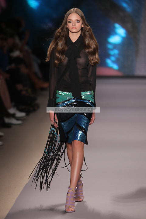 A model walks the runway wearing Vivienne Tam Spring 2010 during Mercedes-Benz Fashion Week at Bryant Park on September 12, 2009 in New York City.