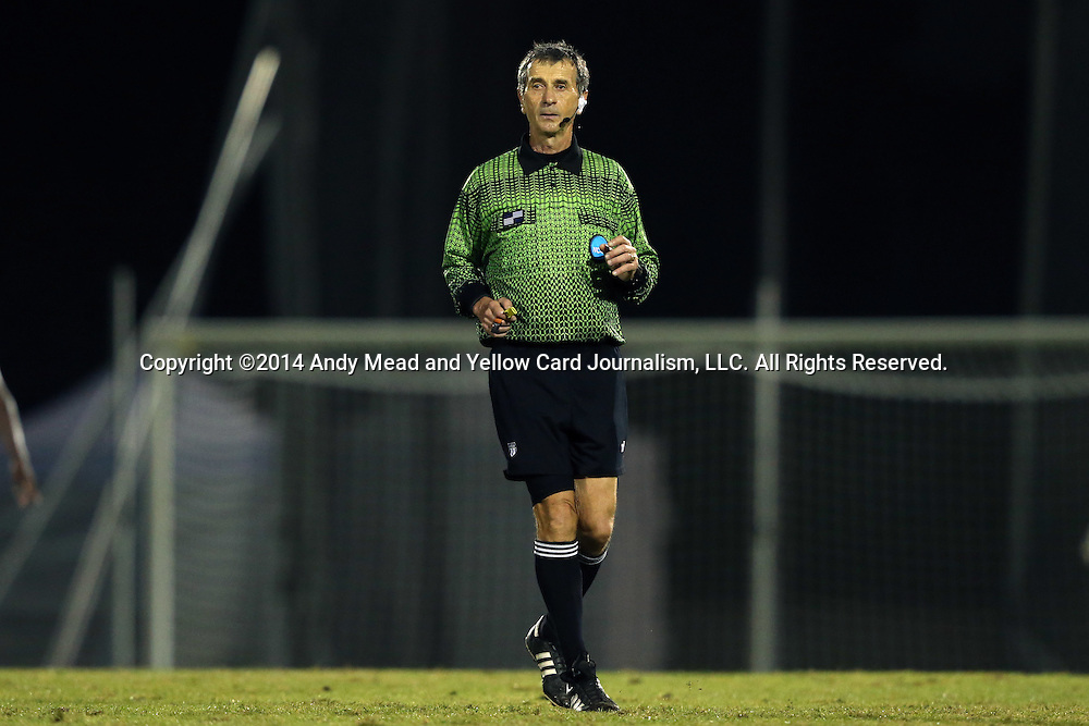 06 December 2014: Referee Alex Gorin. The University of California Los Angeles Bruins hosted the University of North Carolina Tar Heels at Drake Stadium in Los Angeles, California in a 2014 NCAA Division I Men's Soccer Tournament Quarterfinal round match. The game ended in a 3-3 tie after two overtimes. UCLA advanced to the next round by winning the penalty kick shootout 7-6.