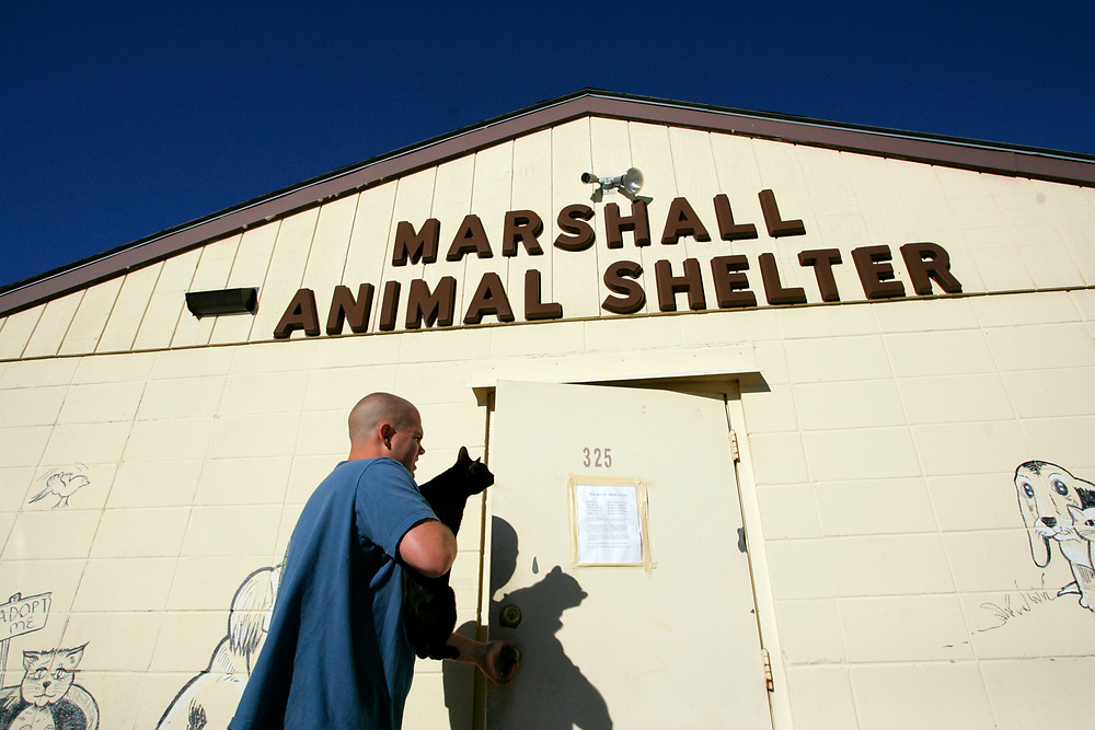 """9/29/05 -- Marshall, MO<br /> <br /> Nick Sweeney takes """"Stitches"""", a family pet, to the Marshall Animal Shelter. The feline was not getting along with the other pets in close quarters and the cost of keeping all the animals was becoming an issue.<br /> <br /> """"People may wonder why we keep all our pets but we already had stocked up on food for the animals. But if we couldn't feed the kids, all the pets would have to go."""" The family has three dogs, two cats, two bald boa snakes and two ferrets. <br /> <br /> Photo by Jack Gruber, USA TODAY staff"""