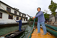 Rowing wooden boats on canal, Zhouzhuang, China