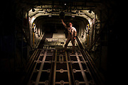 Loadmaster and raised ramp on a Lockheed Martin-built C-130J Hercules airlifter. Externally similar to the classic Hercules in general appearance, the J model sports considerably updated technology. These differences include new Rolls-Royce AE 2100 D3 turboprops with Dowty R391 composite scimitar propellers, digital avionics (including Head-Up Displays (HUDs) for each pilot). During more than 50 years of service the Hercules family has the longest continuous production run of any military aircraft in history. Strategic, automated low-level airdrops keep 60 road transport vehicles and up to 120 supple troops off hostile roads using only three flight crew.