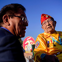 081415       Cable Hoover<br /> <br /> Navajo Codetalker David Patterson chats with Navajo Nation President Russell Begaye before the start of the Codetalker Day parade Friday in Window Rock.