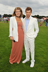 TOM & AMBER AIKENS at the 25th annual Cartier International Polo held at Guards Polo Club, Great Windsor Park, Berkshire on 26th July 2009.