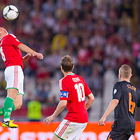 Hungary's Zoltan Gera (C) and Netherlands' Jordy Clasie (R) watches as Hungary's Jozsef Varga (L) jumps for a  header during a World Cup 2014 qualifying soccer match Hungary playing against Netherlands in Budapest, Hungary on September 11, 2012. ATTILA VOLGYI
