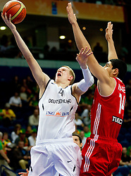 Robin Benzing of Germany vs Enes Kanter of Turkey during basketball game between National basketball teams of Germany and Turkey at FIBA Europe Eurobasket Lithuania 2011, on September 9, 2011, in Siemens Arena,  Vilnius, Lithuania. Germany defeated Turkey 73-67.  (Photo by Vid Ponikvar / Sportida)