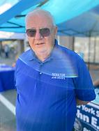 Bellmore, New York, U.S.  September 25, 2021.  New York State Senator JOHN BROOKS (Democrat) speaks with visitors at the 34th Annual Bellmore Family Street Festival.