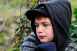 12 yr old boy in hoodie in a nature reserve. Berkshire. MR