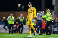 Colchester United fans on the pitch celebrating  while Tottenham Hotspur goalkeeper Paulo Gazzaniga (22) looks devastated during the EFL Cup match between Colchester United and Tottenham Hotspur at the JobServe Community Stadium, Colchester, England on 24 September 2019.