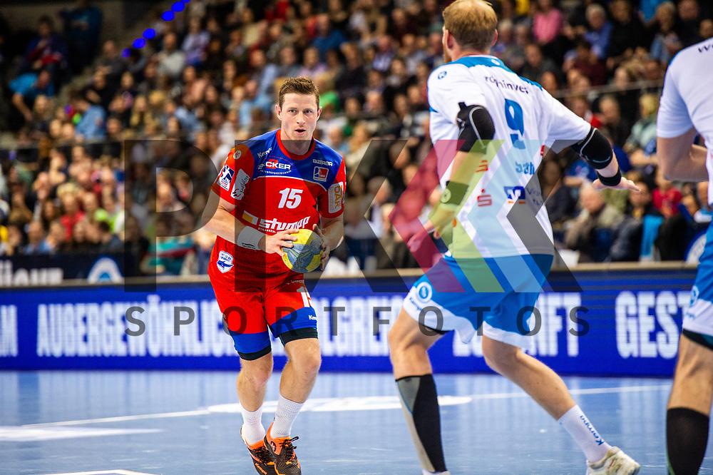 Martin Strobel (HBW Balingen-Weilstetten #15) ; Manuel Spaeth (TVB Stuttgart #9) beim Spiel in der Handball Bundesliga, TVB 1898 Stuttgart - HBW Balingen-Weilstetten.<br /> <br /> Foto © PIX-Sportfotos *** Foto ist honorarpflichtig! *** Auf Anfrage in hoeherer Qualitaet/Aufloesung. Belegexemplar erbeten. Veroeffentlichung ausschliesslich fuer journalistisch-publizistische Zwecke. For editorial use only.